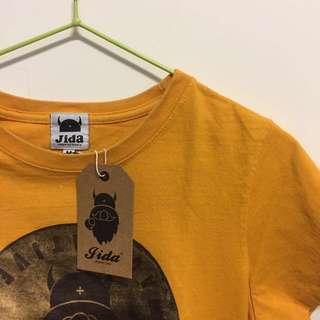 🚚 gida 橘黃色經典小人圖案短袖T 全新吊牌未拆