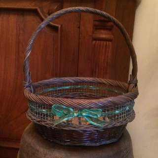 Vintage wicker basket with green ribbon