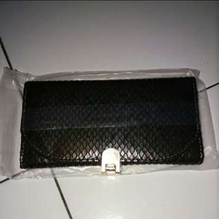 Dompet fossil oriflame