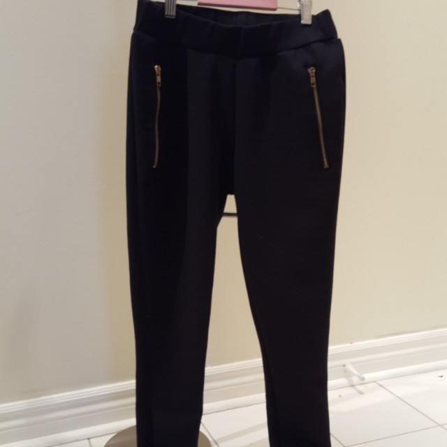 Black leggings with gold zipper pockets