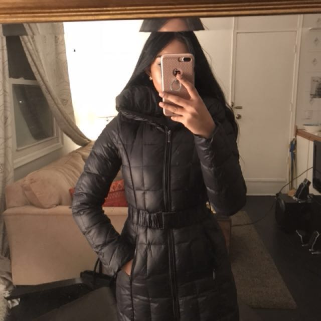 Puffer coat with a slimming belt