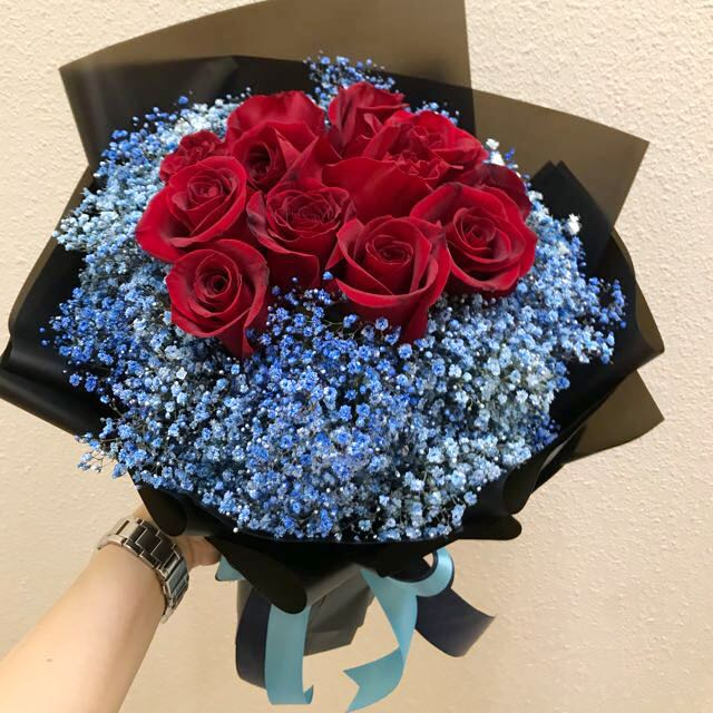 Red roses bouquet and blue baby breath bouquet