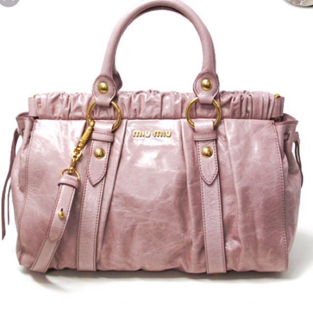765b3f74d403 REPRICED Auth miu miu sling bag