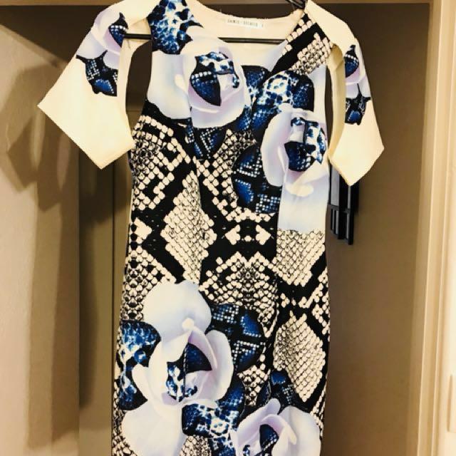 SAINTS SECRETS CUT OUT DRESS