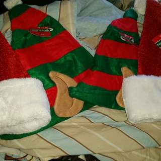 New with tags! Santa Hats and Elf hats