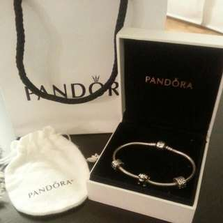 Pandora bracelet With Charm And Two Clips.