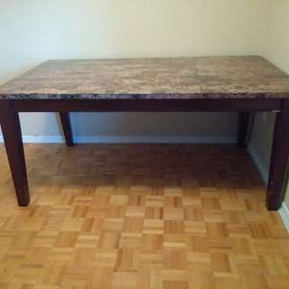 Corrugated marble top 8 seat table. Like new