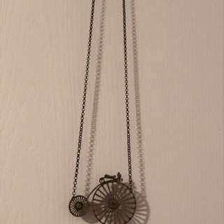 Penny farthing long necklace