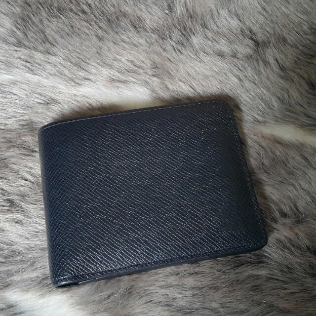 Louis Vuitton Taiga Bi- Fold Wallet