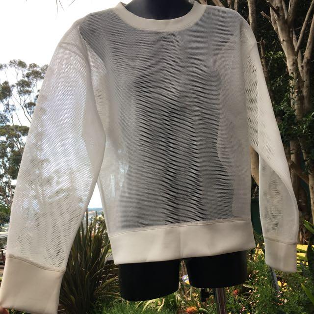 White mesh staple the label jumper
