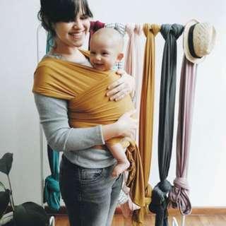 mikhadou baby sking carrier in pumpkin
