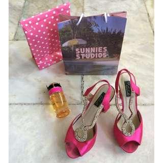 Pink open-toed heels