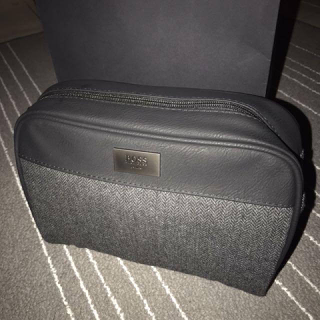 53525715bbf Hugo boss men clutch, Men's Fashion, Bags & Wallets on Carousell