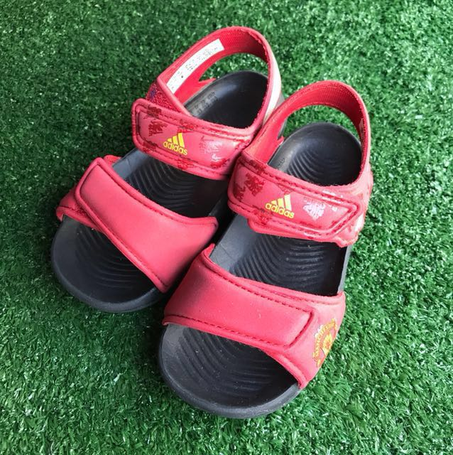 ca8565458955 Kids Adidas Akwah 9 Manchester United on Carousell
