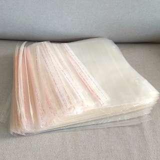 Self adhesive transparent packing bag