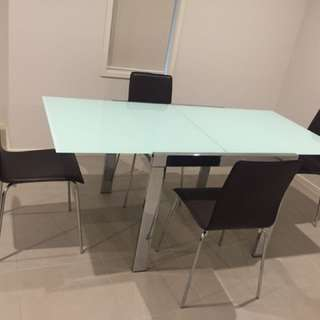 Frosted glass extendable dining table and chairs