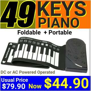 PORTABLE PIANO (49 KEYS ROLL UP FOLDABLE) with + 10 RHYTHMS/16 TIMBRES/8 DRUMS SET.  Carry a piano in your bag and go. UP: $79.90 Special Offer:$ 44.90