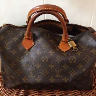 Authentic Louis Vuitton  Speedy 30, in monogram canvas and leather trims  Rolled handles  Good condition, beautifully honeyed patina, crease line on canvas would need some smoothing out.  Comes with Lock + Key