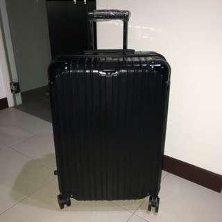 Brand new 24 inch TSA black hard casing luggage *free gifts*