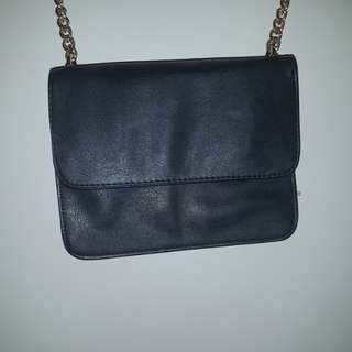 Small cross body clutch