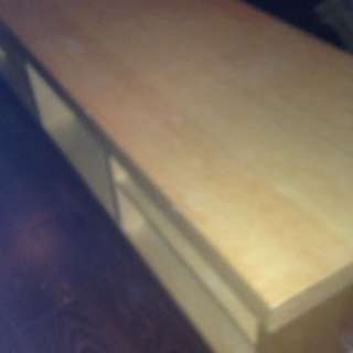 Ikea Tv table with shelves and rolling wheels
