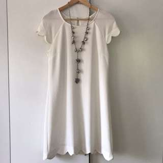 Scallop edged white dress