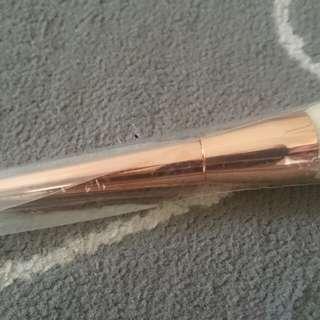 Rose gold power brush. New