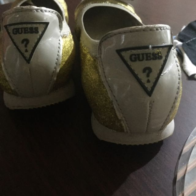 Authentic Guess gold flat shoes