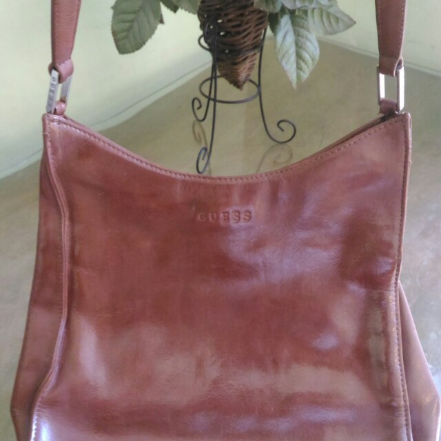 Brown Guess bag with flaw
