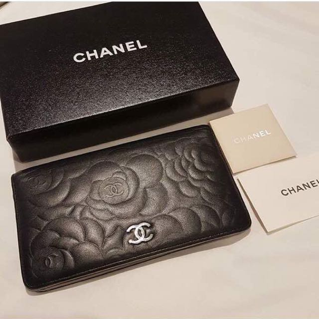 Chanel camillia embossed leather bi-fold wallet