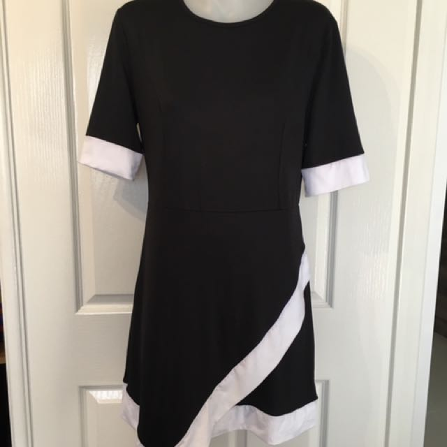 Elite 99 black and white dress Size 16 but would fit 12-14