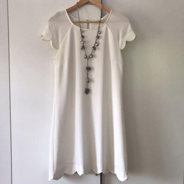 Scallop edged white dress
