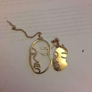 Unique gold/silver earrings