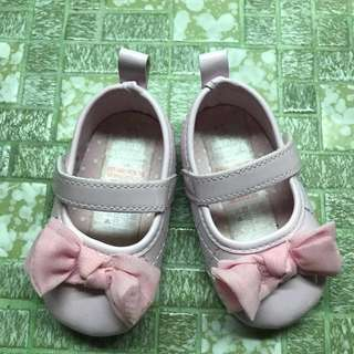 Pink baby shoes with nice ribbon
