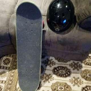 Darkstar skateboard and Protec helmet