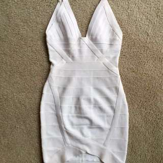 White bodycon dress Herve Leger style.