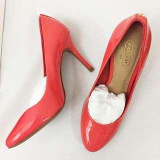 Coach orange heels