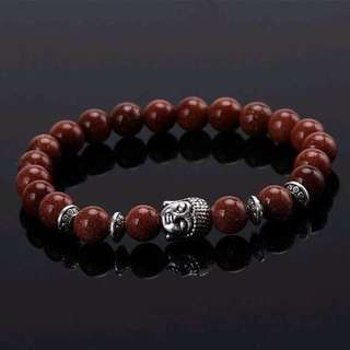 Goldstone Bead Bracelet with Buddha Head Charm