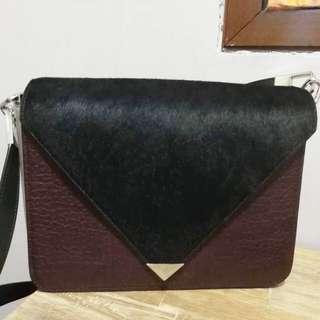 Used Alexander Wang fur and leather sling bag