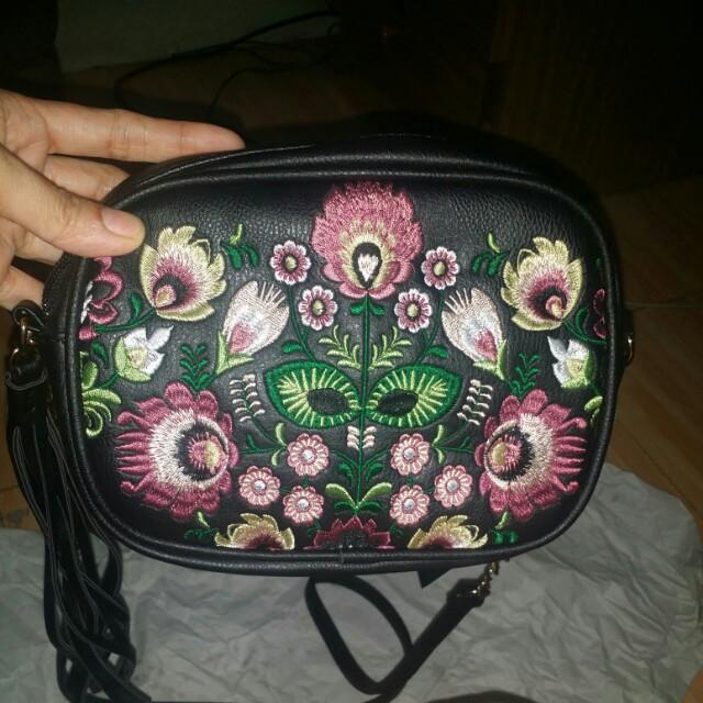 Embroidered mini sling bag