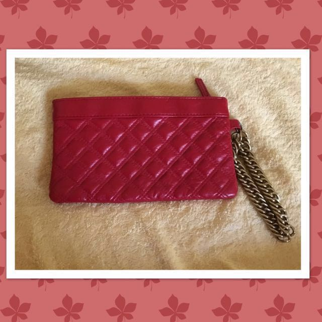 Red quilted clutch
