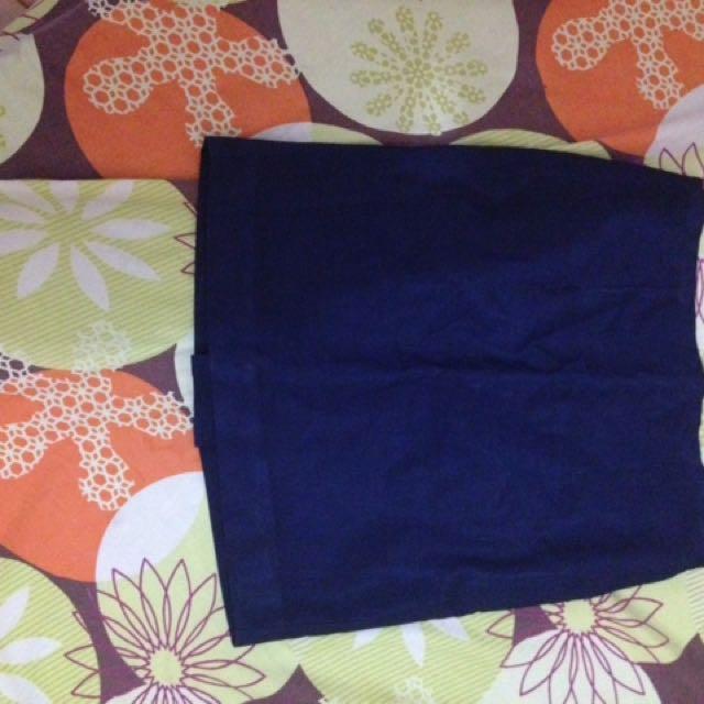 Short, blue office skirt