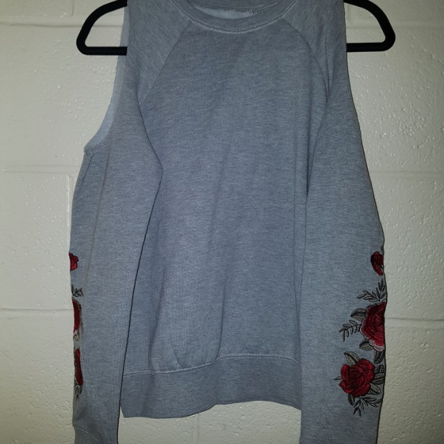 Sweater with shoulder cut outs
