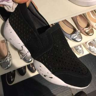 Staccato black and white sneakers slip on