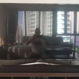 "Samsung 55"" UHD Smart TV with sound bar"