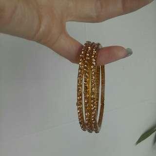 3 sparkly bracelets golden color