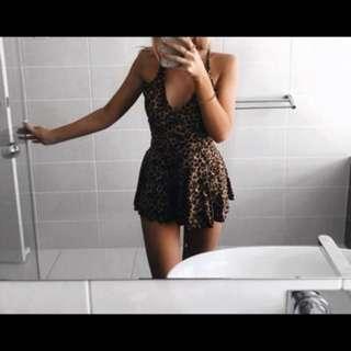 Cheeta playsuit size 6