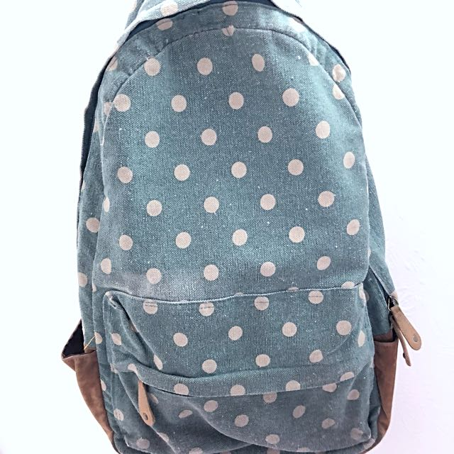 Backpack with blue polka dots