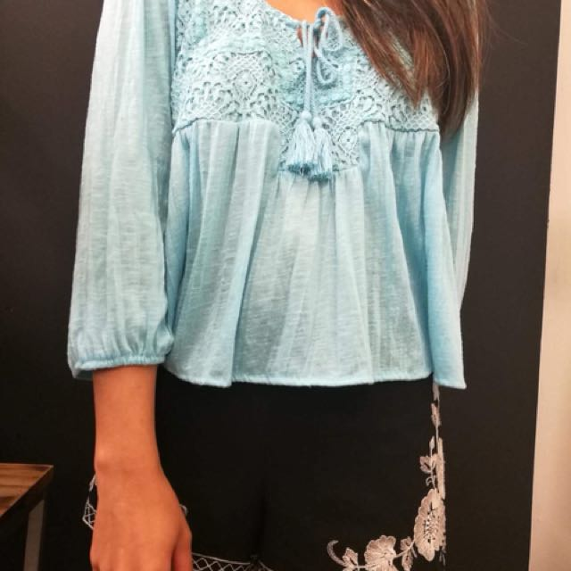 Blue frilly top