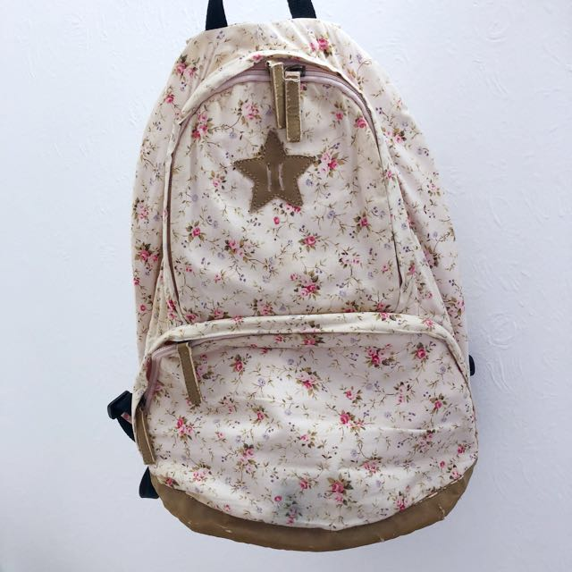 Pink backpack with floral print